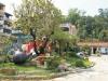 以「紅瓦、綠意、藍渠」為主題的龍目社區
